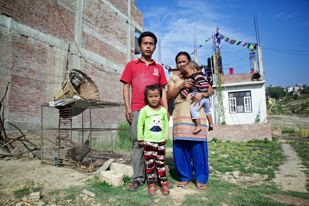 Rasmina along with her parents and her 15 month old brother, Ganesh Lama, outside her house in Banepa. Photo Credit: Mithila Jariwala
