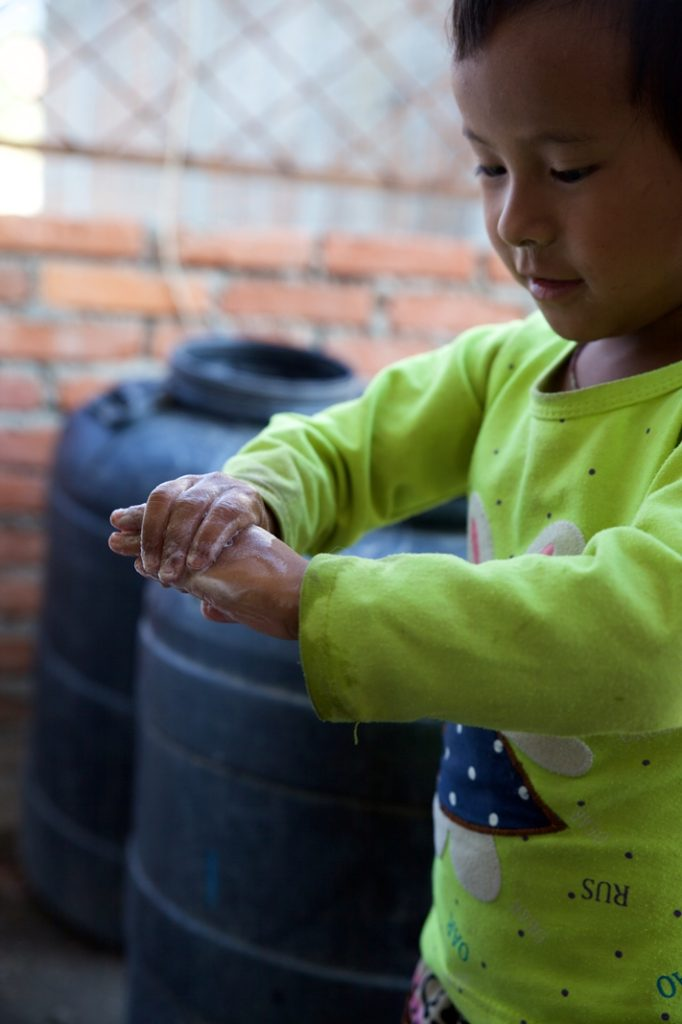 Rasmina practices washing her hands with soap after being taught about hygiene and sanitation practices upon discharge from Dhulikhel Hospital. Photo Credit: Mithila Jariwala