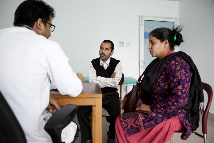 Yogendra and his wife Parvati consult a doctor during his follow up visit. Photo Credit: Mithila Jariwala