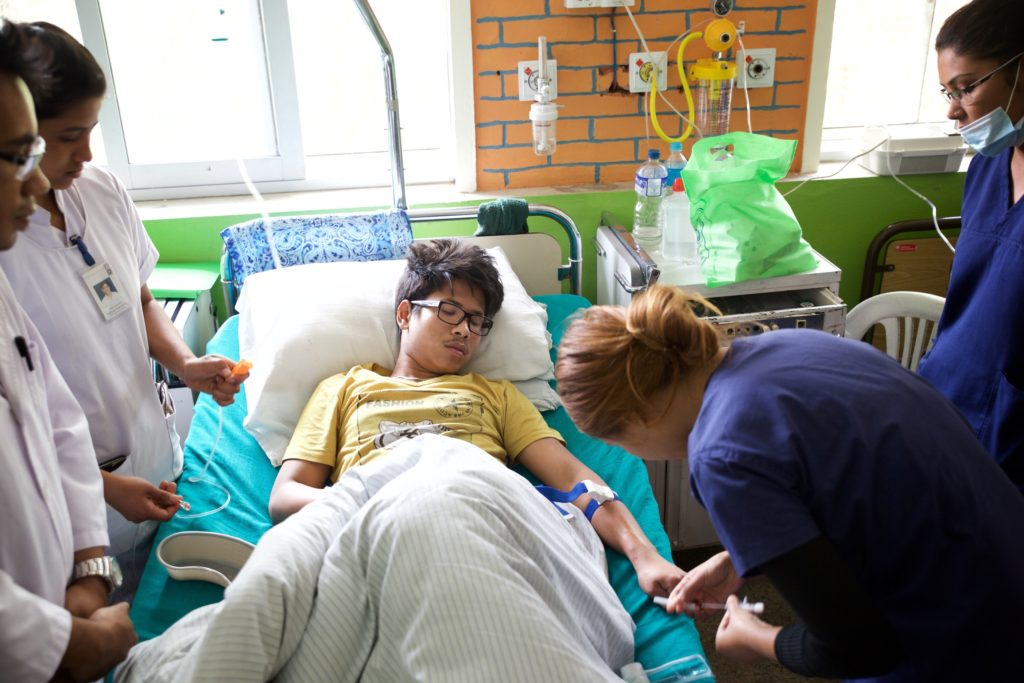 Suzen getting his blood drawn in Dhulikhel Hospital. He had high fever for 10 days before he was admitted to the hospital. Photo Credit: Mithila Jariwala
