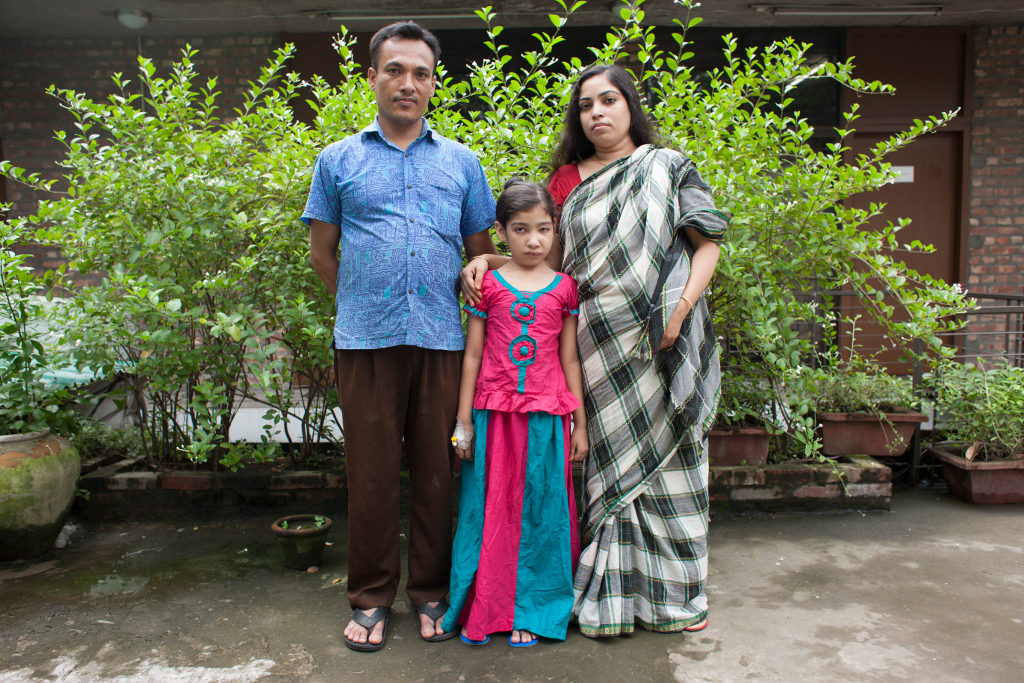 Nishita, 9, poses with her parents, Motiar and Rehana. Photo credit: Suvra Kanti Das