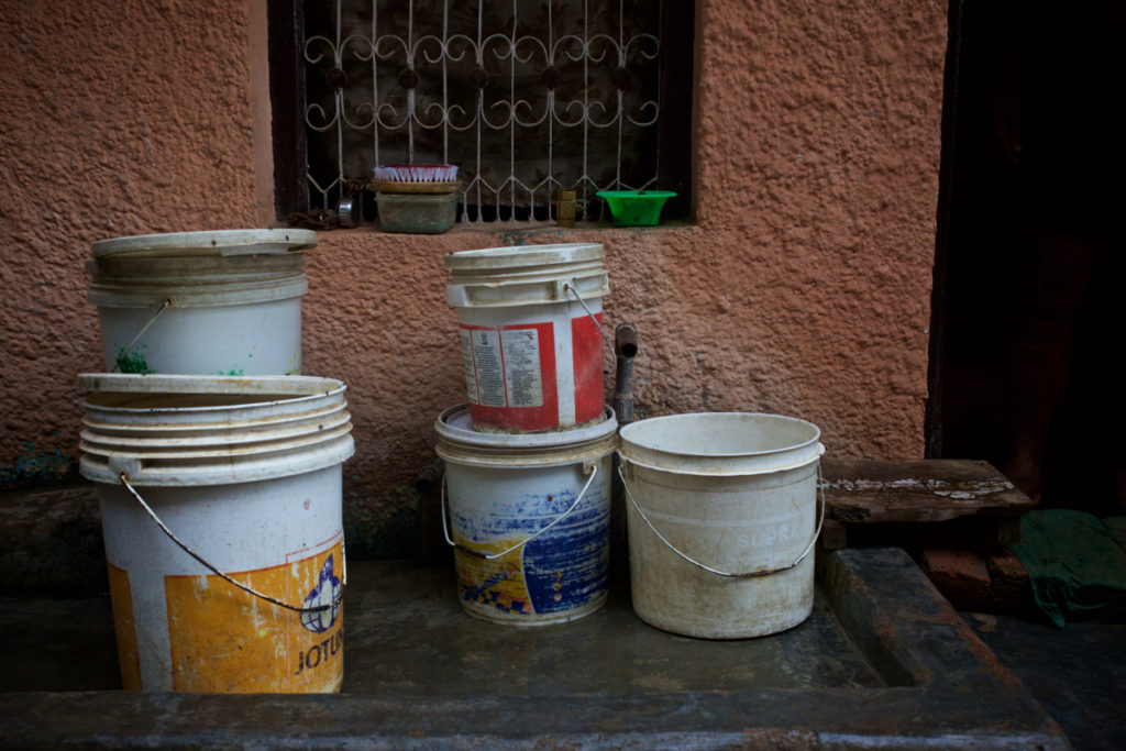 Water is scarce in Yadav's home village and buckets on the street in Jharsa hold many residents' water supply, leaving it exposed to contamination from bacteria that causes typhoid and other diarrheal diseases. (Photo credit: Mithila Jariwala)