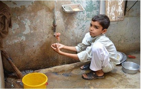 Asim scrubs his hands with soap and water after coming back from playing with his friends.
