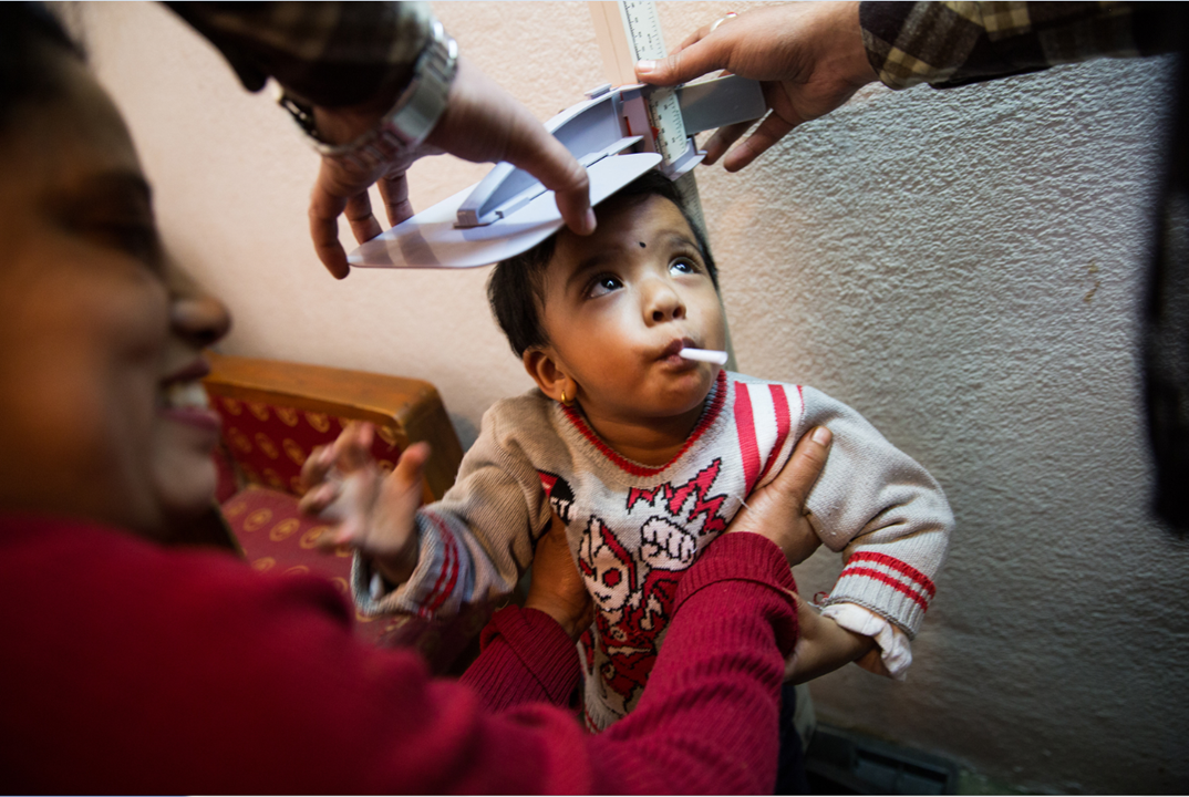After enrolling in the study, children receive a general examination to ensure they are fit for vaccination. For children under five, trial staff make sure to measure their height and weight.