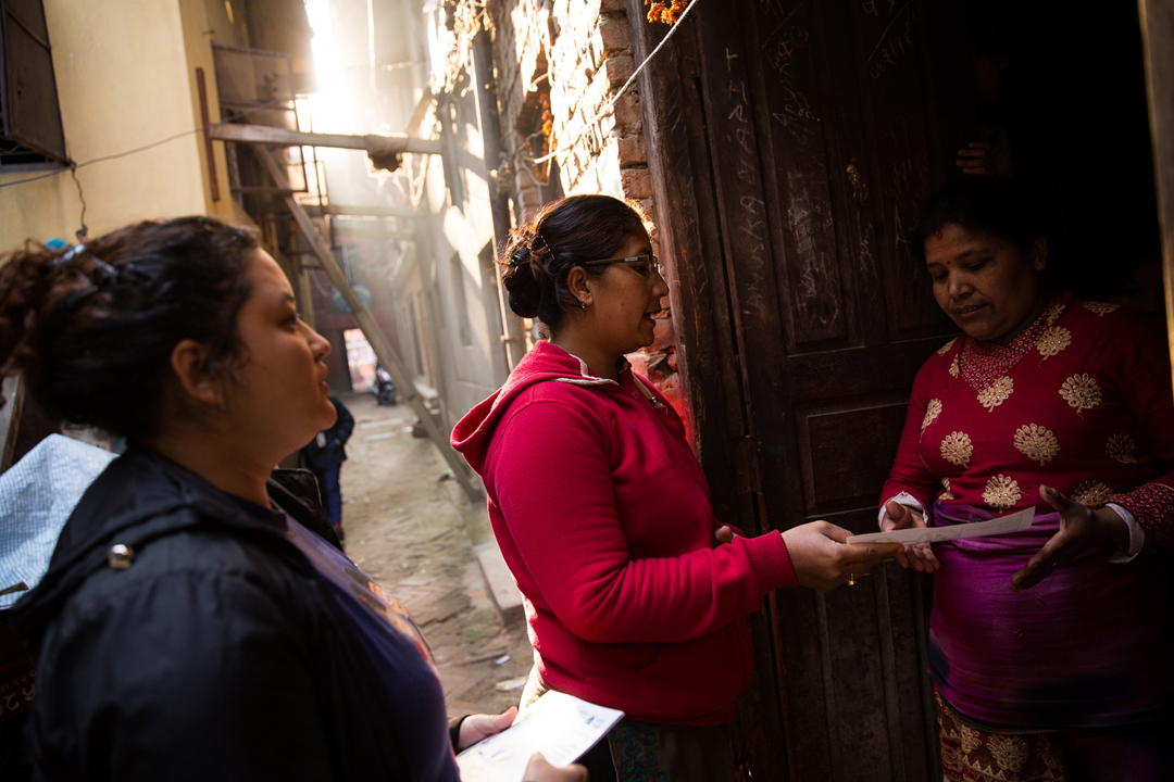 Before launching the vaccine trial, project staff conducted community outreach activities in the Lalitpur District of the Kathmandu Valley where the trial would be conducted. Activities ranged from staff going door-to-door and visiting local mothers' groups to meetings with the district's Public Health Division and locally elected representatives.