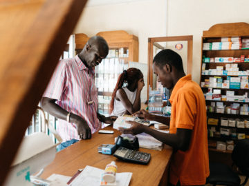 People purchase medication at the Pharmacie Bakh Yaye in Thies, Senegal. PATH