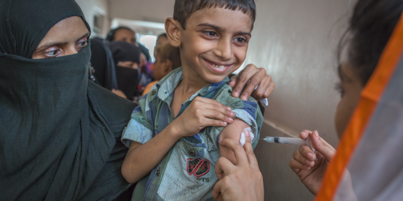 Photo shows boy in Pakistan receiving TCV