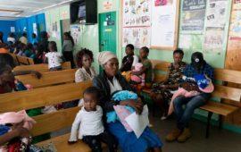 Angela Godfrey, age 26, and her daughter Sara Kambua, age 5, wait in the health clinic in Mukuru, Kenya, February 5, 2018.