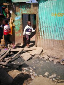 temporary housing and open sewer in Mukuru, Kenya