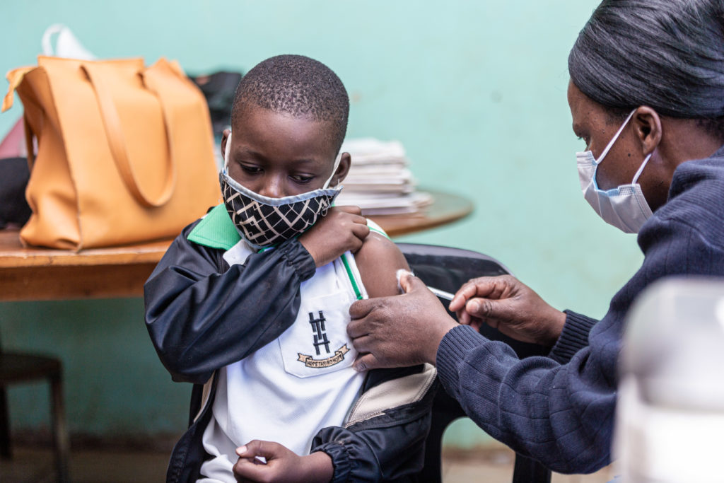 A child receives TCV during the campaign in Zimbabwe.