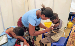 Health care worker administers TCV to a boy as part of the TCV trial in Malawi